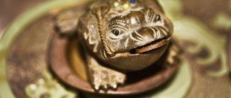 Жаба с монеткой - символ богатства